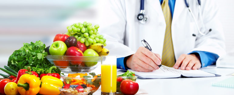 Nutritionist doctor man with vegetables working in the office